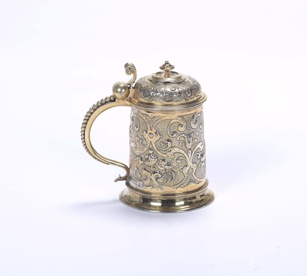 A tankard in molten, embossed, chiselled and gilded silver, Ausburg, first quarter of the 17th century,  [..]