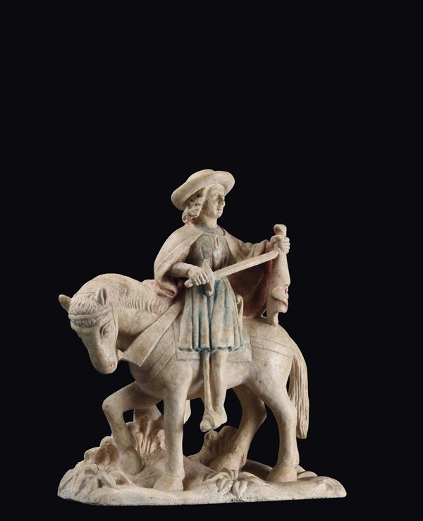 A limestone sculpture with traces of polychromy, depicting Saint Martin cutting the cape, Burgundian art from the beginning of the 16th century