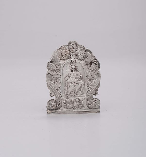 A Baroque peace in embossed and chiselled silver, depicting a Pietà, Venice, 17th century (marks of a lion in moleca, of the silversmith and the assayer).