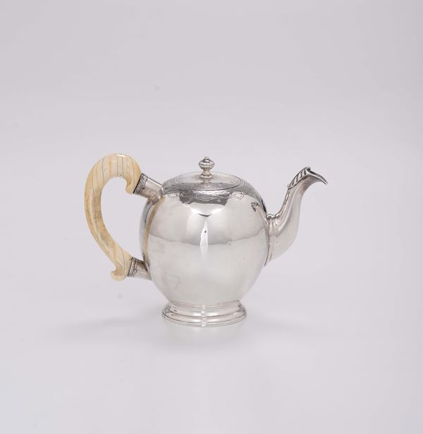 A teapot in molten, embossed and chiselled silver, Switzerland 18th century, marks for the city of Geneva and silversmith ET with a crown and star