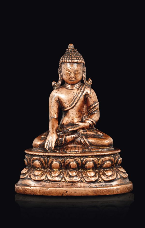 A bronze figure of Buddha seated on a double lotus flower, China, Ming Dynasty, 14th century