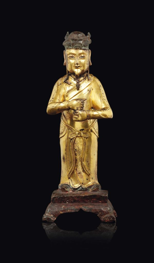 A gilt bronze figure of a standing dignitary, China, Ming Dynasty, 17th century