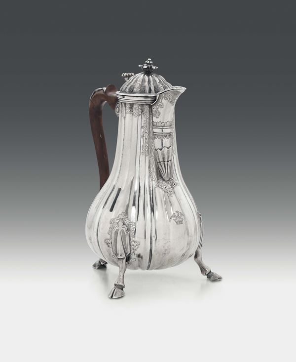 A coffee pot in molten, embossed and chiselled silver, Malta, first half of the 18th century, silversmith  [..]