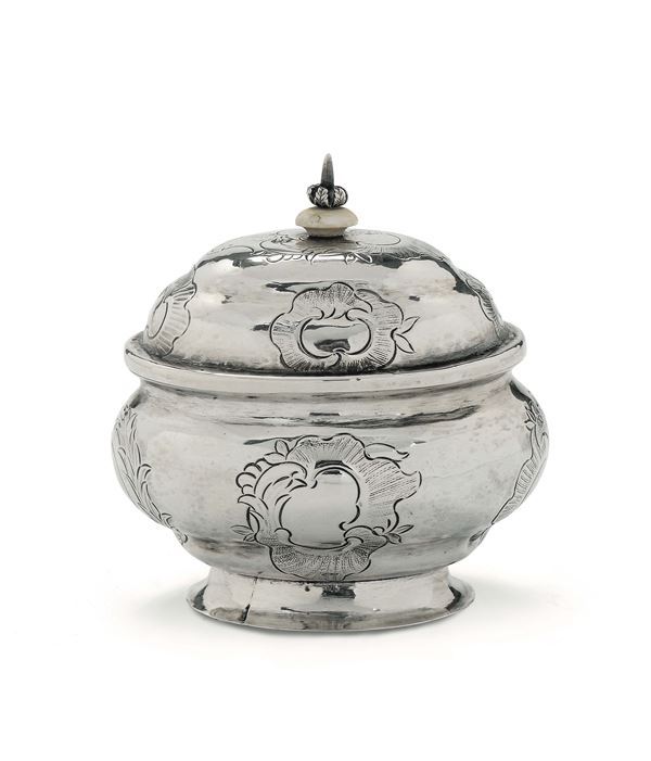A sugar pot in molten, embossed and chiselled silver, Moscow 1762, silversmith Gabriel Sontag (1747-1780), punches for unidentified assayer and for checker Fedor Petrov (1759-1784)