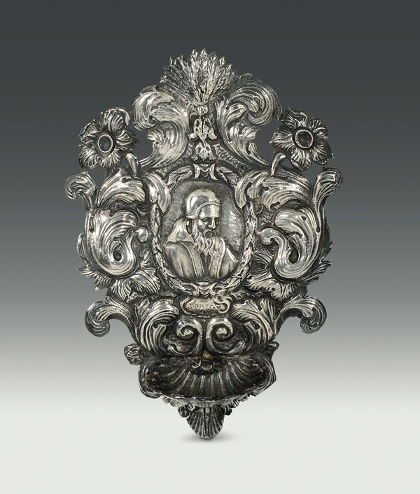 A holy water font in embossed and chiselled silver, Genova, end of the 17th century
