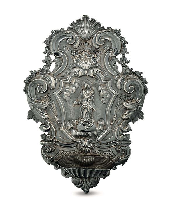 A holy water font in embossed and chiselled silver, Genova, first half of the 18th century