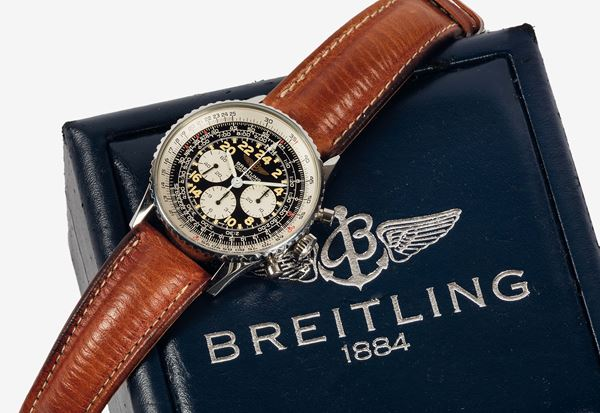 BREITLING, Genève, Navitimer-Cosmonaute, Ref. A12019. Fine, water-resistant , stainless steel  wristwatch with 24- hour dial, round button chronograph, registers, telemeter, slide-rule and a stainless steel Breitling buckle. Accompanied by the original box, papers and Guarantee. Made in the  1990's.