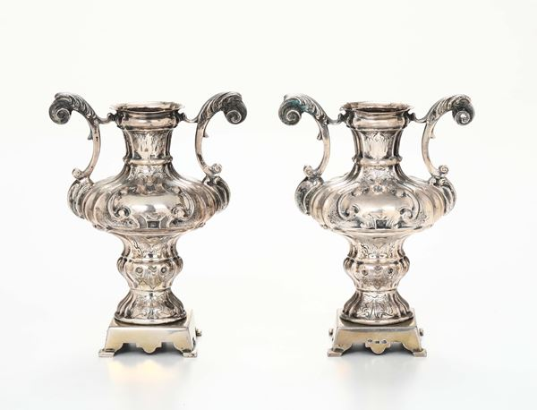A pair of vases in in molten, embossed and chiselled silver, Italy likely 18th century. Base in gilded silver with Fascio punches