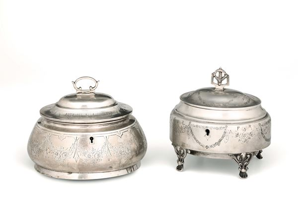 Two sugar pots in molten, embossed and chiselled silver, with locks, Vienna 19-20th century. Title stamps in use from 1866 to 1922 and unidentified marks for silversmiths VC and JK