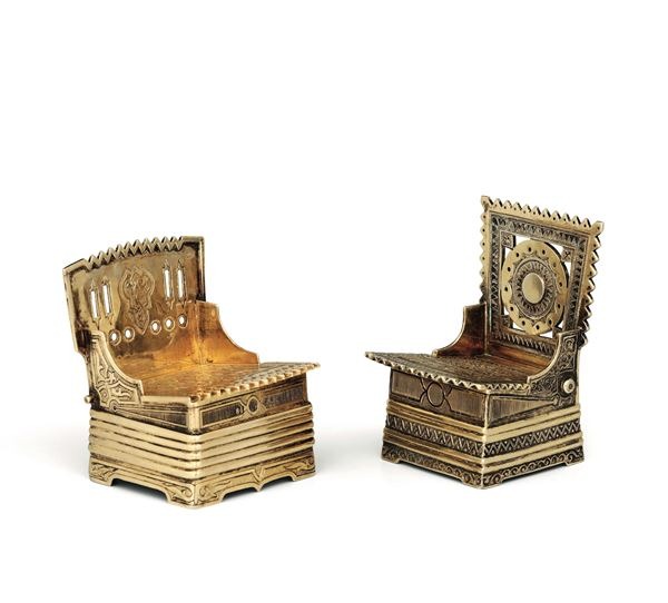 Two throne-shaped salt cellars in molten, embossed, chiselled and gilded silver, Russia 19th century, Moscow 1873 assayer Viktor Savinkov, Moscow 1867 assayer G(?)C
