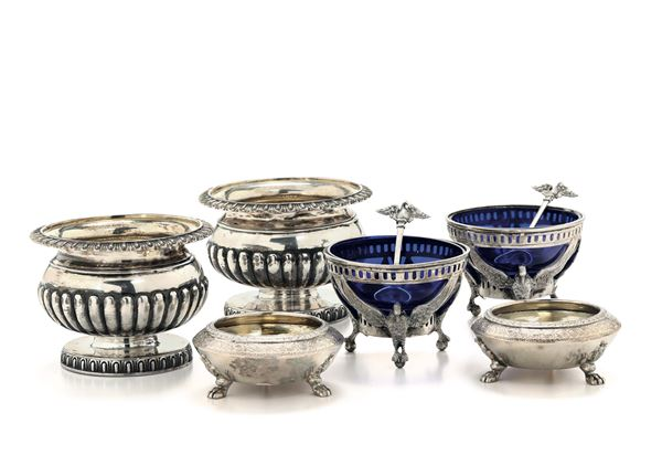 Three pairs of salt cellars and mustard bowls: one pair with a vase-shaped decorated body, London 1807; one pair with two circulars and beast feet, London 20th century; one pair with a stand in the shape of a pellican and a perforated edge, cobalt blue glass, Germany 19th or 20th century