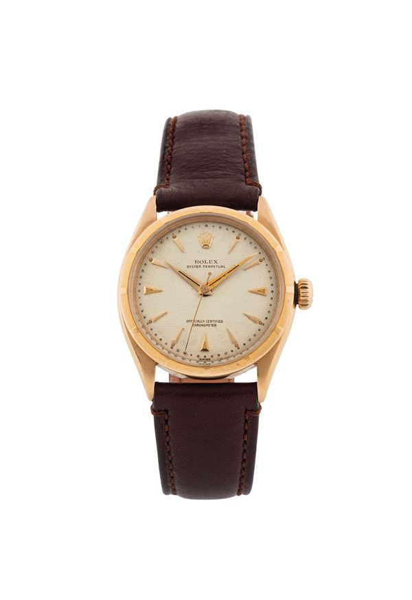 ROLEX,  Oyster Perpetual, Officially Certified Chronometer, HONEYCOMB DIAL, Ref. 6285, 18K yellow gold, water resistant, self-winding wristwatch. Made circa 1950
