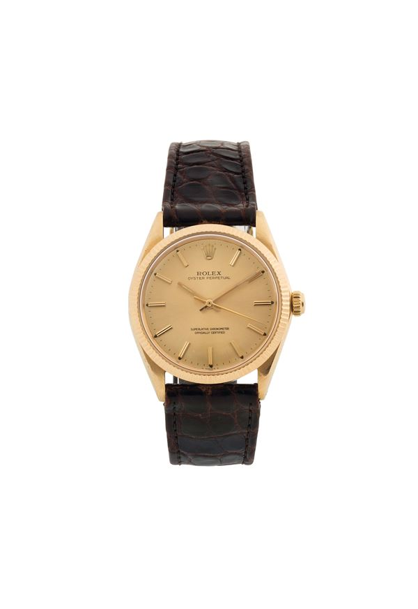 ROLEX, Oyster Perpetual, Superlative Chronometer, Officially Certified, case No. 1273003, Ref. 1005.  Fine, center seconds, self-winding, water-resistant, 18K yellow gold wristwatch with gold plated Rolex buckle. Made circa 1965