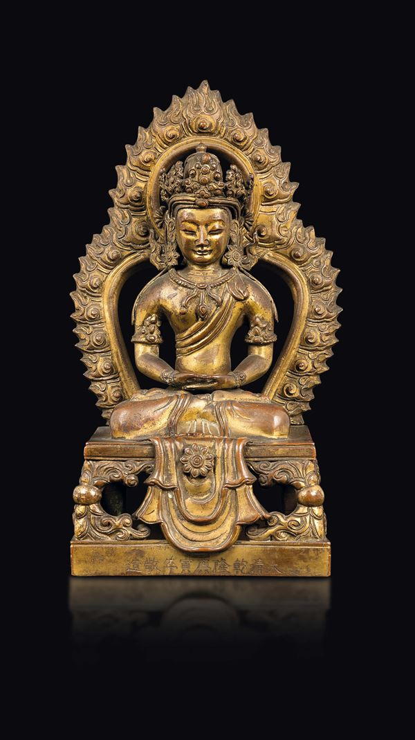 A gilt bronze figure of Amitayus with aura, China, Qing Dynasty, Qianlong Mark and of the Period (1736-1795)