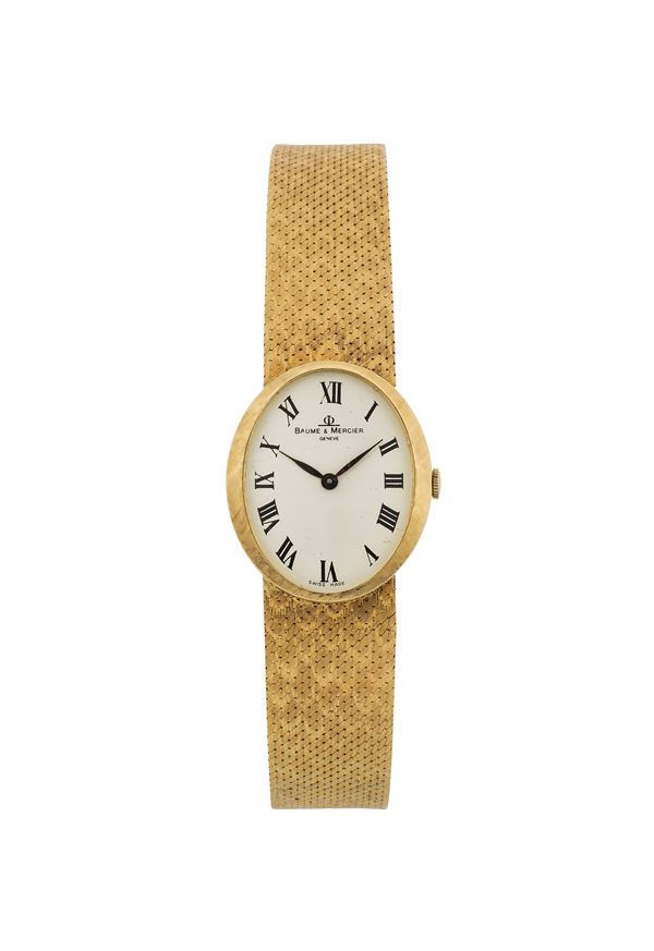 BAUME & MERCIER, Geneve, Ref. 37043, 18K yellow gold, lady's wristwatch with an original gold integrated bracelet. Accompanied by the original box and Guarantee. Made circa 1970