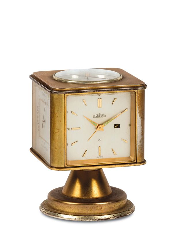 Angelus, desk Weather Station. Fine, gilt brass, four-dialed, eight-day going, keyless revolving desk timepiece with date, hygrometer, barometer and thermometer in Fahrenheit and Centigrade. Made circa 1970