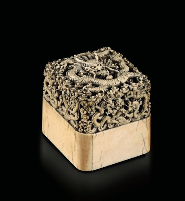 A rare finely carved ivory seal with dragons between clouds in relief, China, Qing Dynasty, Qianlong  [..]