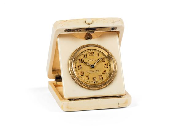 W. BARRET&SON, 9 Old Bond Street, London W1, avory cased and silver small travel clock with 8 days power reserve. Made circa 1920