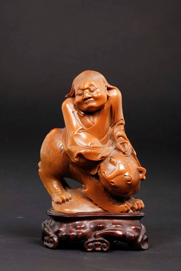 A soapstone figure of wiseman on a panther, China, Qing Dynasty, 19th century
