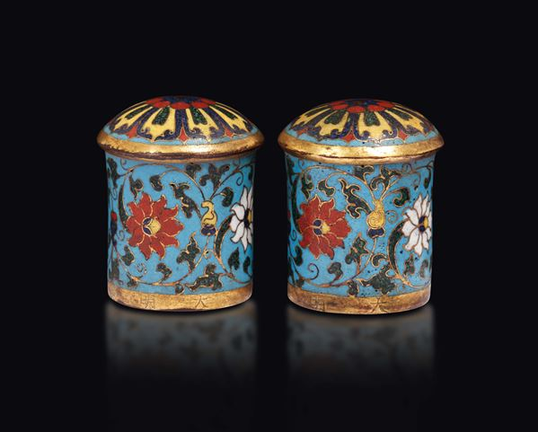 A pair of cloisonné enamel scroll ends with Ming inscription, China, Qing Dynasty, 18th century