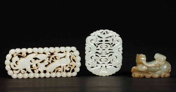 Three carved white jades, a pendant, a Pho dog and a fretworked one with birds, China, 20th century