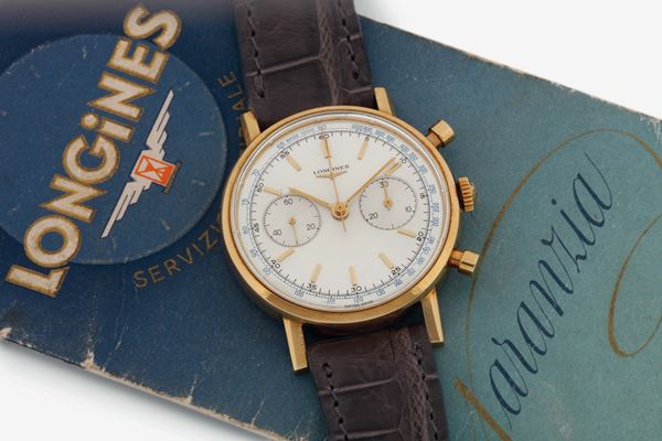 LONGINES, REF. 7415, movement No. 117022.16. A fine and very rare 18K yellow gold fly-back chronograph wristwatch with tachymetre scale and original buckle. Made in the late 1960's. Accompanied by the original box and Guarantee