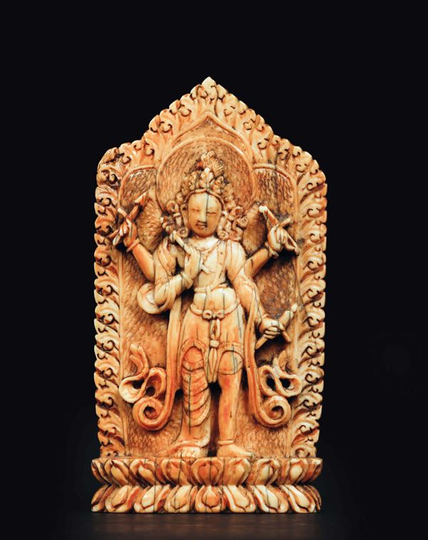 A carved ivory plaque with deity on a lotus flower with ritual instruments in his hands, china, Ming  [..]