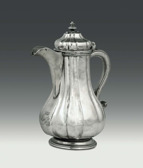 A chocolate pot in embossed, molten, chiselled and engraved silver, Naples 1740, cameral stamp with  [..]
