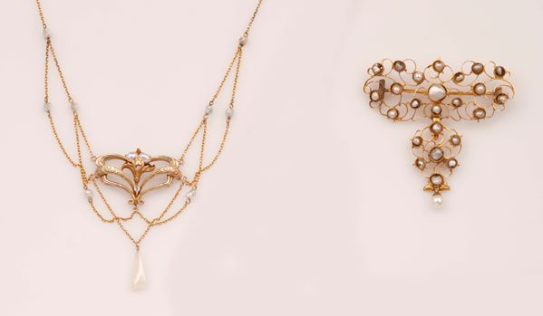 A gold and pearl necklace  and a gold and pearl brooch