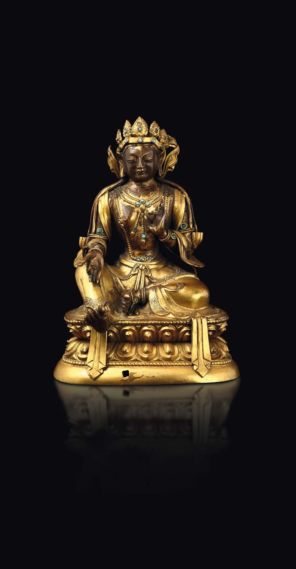 A gilt copper repoussé figure of Amitayus with turquoise inlays seated on a double lotus flower, China, Qing Dynasty, 18th century
