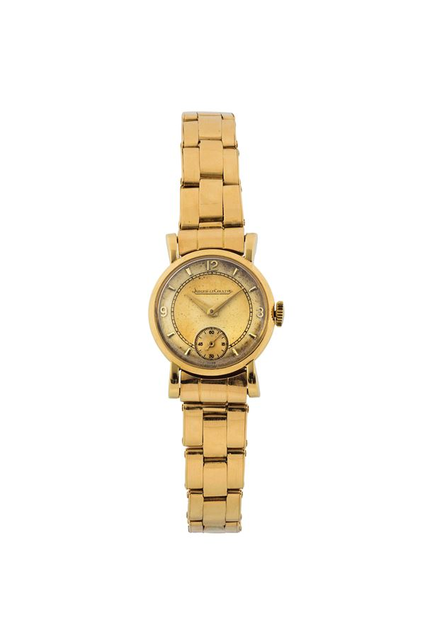 JAEGER LeCOULTRE, case No. 35 0405, fine, 18K yellow gold lady's wristwatch with gold riveted elastic bracelet and deployant clasp. Made circa 1950