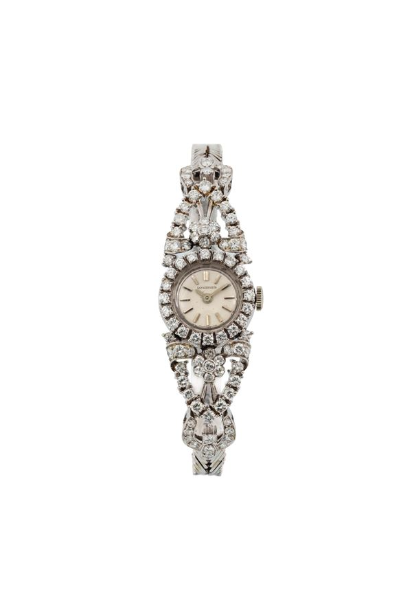 LONGINES, very fine and elegant 18K white gold and diamonds lady's wristwatch with gold bracelet. Made circa 1960