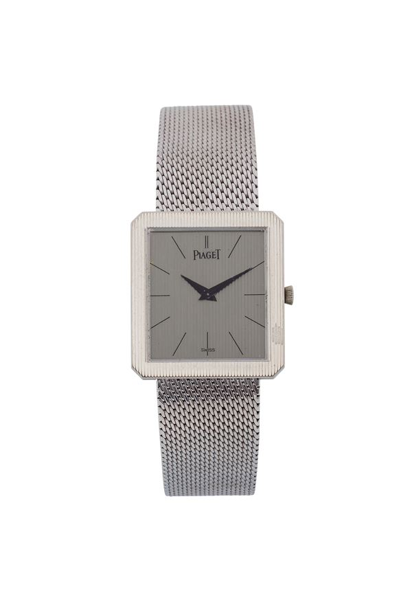 PIAGET, Ref. 9154, 18K white gold square shaped wristwatch with gold integrated bracelet with deployant clasp. Made circa 1960