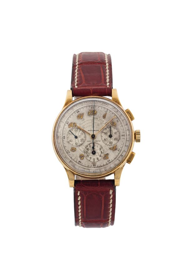 Movado, Ref. 9020,  fine and rare, 18K yellow gold chronograph wristwatch with registers, telemeter and tachometer. Made in the 1940's