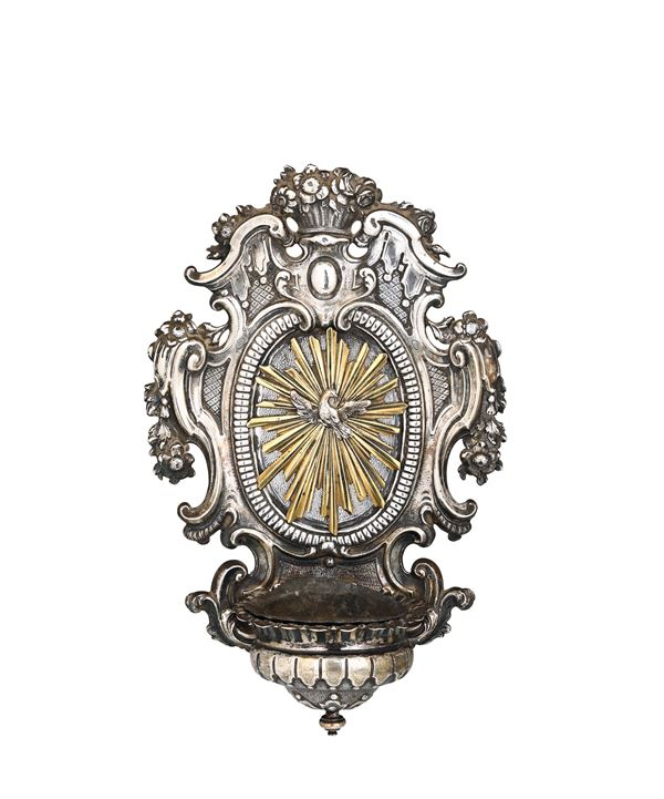 A holy water font in molten, embossed, chiselled and gilded silver and bronze, Lucca 18th century. Mark for silversmith Michelangelo Vambre (1714-1765)