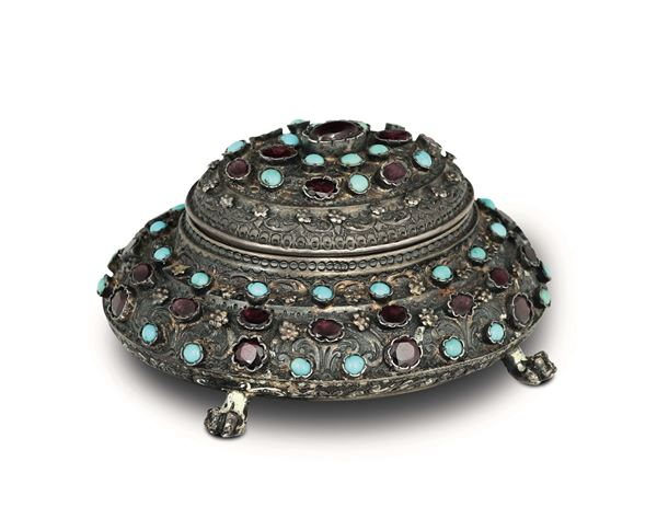 A casket in molten, embossed, chiselled, gilded silver, with turquoise and garnet stones, Austro-Hungarian empire, city of Pest stamps in use from 1867 to 1921