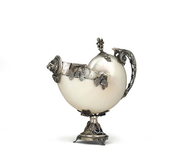 A Nautilus with a frame in molten, embossed and chiselled silver, Italy 20th century