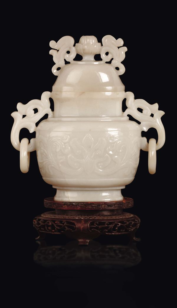 A white jade vase and cover with archaic style motif, China, early 20th century