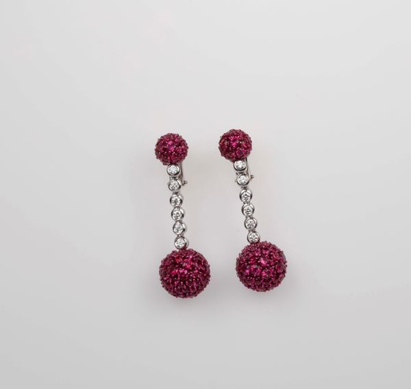 Pair of ruby and diamond pendent earrings