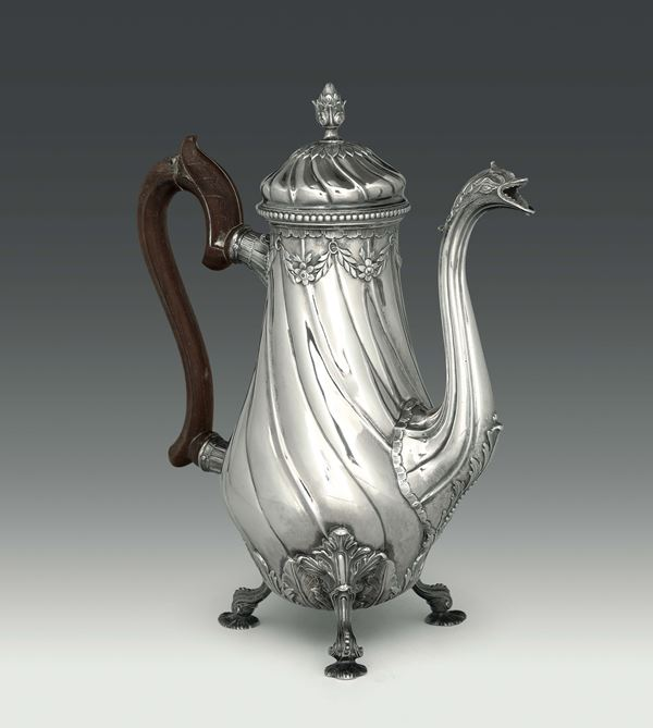 A coffee pot in molten, embossed and chiselled silver, Portugal, Lisbon first half of the 18th century, mark for silversmith FS (unidentified)