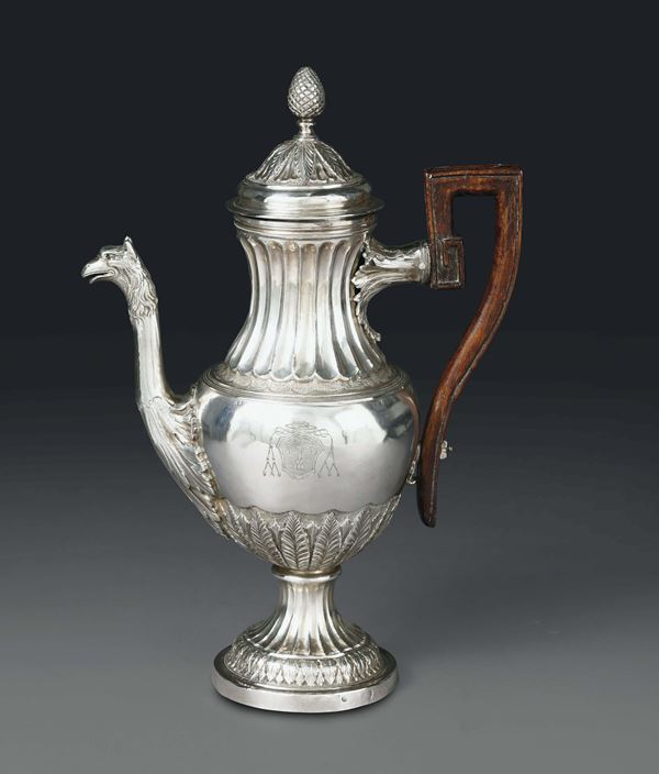 A coffee pot in embossed and chiselled silver, Rome, cameral stamp for 1799 - 1808 and mark for silversmith Carlo Sciolet (1801 - 1830)