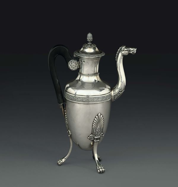 A coffee pot in molten, embossed and chiselled silver, Paris, guarantee stamps in use from 1809 to 1819 and from 1819 to 1838 and silversmith's mark