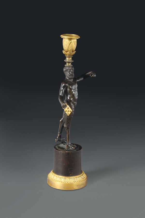 A bronze candle holder with faun, France 19th century