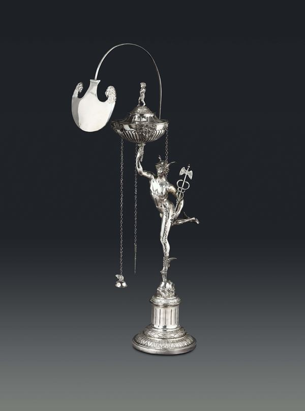 An oil lamp in molten, embossed and chiselled silver, Rome, Roman cameral stamp (in use between 1815 and 1870) and mark likely belonging to goldsmith Filippo Pacetti (1809 – 1857).