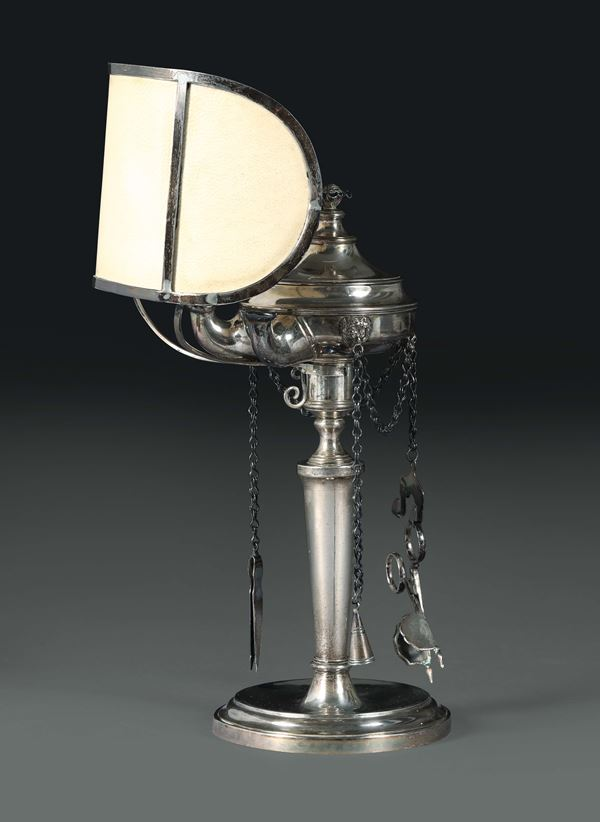 A small oil lamp in molten, embossed and chiselled silver, Venice, 19th century, guarantee marks in use from 1810 on (Ornament and Globe).
