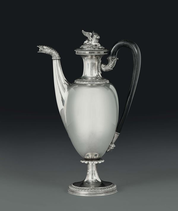 A Charles X coffee pot in molten, embossed and chiselled silver, Milan, half of the 19th century