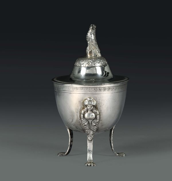 A sugar bowl in molten, embossed and chiselled silver, Naples, first half of the 19th century, stamp probably belonging to essayer Paolo De Blasio (1832 - 1835) and mark for silversmith Michele Pane.