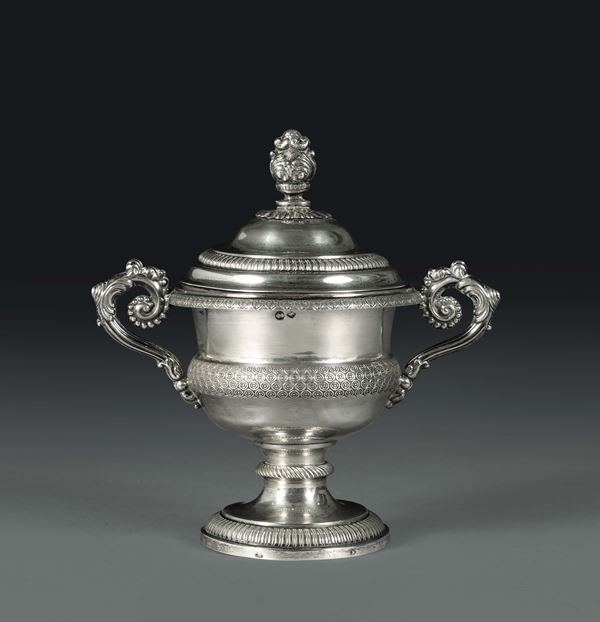 A sugar pot in molten, embossed and chiselled silver, Turin, 19th century, control stamps and recognition mark in use from 1824