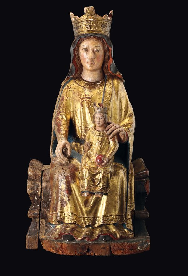 A sculpture in polychrome, gilt wood, depicting the Madonna and child, Catalan sculptor active in the 14th century.