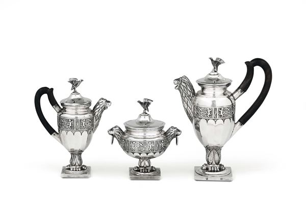A tea or coffee service in molten, embossed and chiselled silver, Northern Europe (?) 19th century, unidentified title marks and silversmith's mark